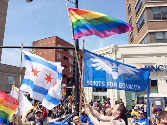 Scouts For Equality — Chicago chapter members — serve as the color guard on June 28 for the Chicago Pride Parade. The lifting of the Boy Scouts of America's ban on gay adult leaders prompted some gay Eagle Scouts to quickly rejoin the movement on Tuesday.
