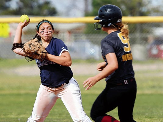 VICTOR CALZADA-EL PASO TIMES Chapin's Ariana Valles throws to first past Andress' Daniela Vargas to trtry and complete a double play Friday. Vargas was out at second, but the throw to first was late.