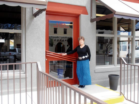 Flickinger Board Member and 2015 Campaign Coordinator Teresa Ham stands at the entrance of the new Patron's Hall and Western Heritage Museum.