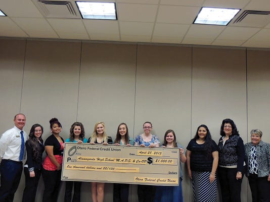 From left to right: Otero Federal Credit Union Vice President of Marketing Darro Pannell, OFCU employee Makenzie Moffitt and Co-Op students Whitney Luna, Emily Schalk, Madison McNeile, Samantha Morris, Rebecca Cook, Kayla Spencer, Angelica Montoya, and OFCU VP of Human Resources, Elsa Montoya and Director of MAPS & Co-Op  Dina Scarafiotti.