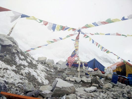 This photo provided by Azim Afif, shows the scene at Everest Base Camp, Nepal on Tuesday, April, 28, 2015. On Saturday, a large avalanche triggered by Nepal's massive earthquake slammed into a section of the Mount Everest mountaineering base camp, killing a number of people and left others unaccounted for. Afif and his team of four others from the Universiti Teknologi Malaysia (UTM) all survived the avalanche.