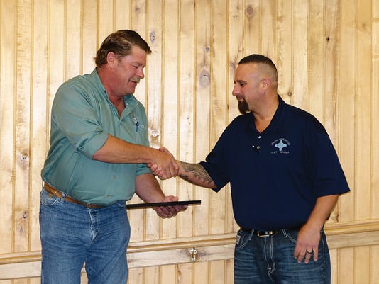"""Public Works Director J. R. Baumann, left, congratulates Adam Sanchez, water distribution manager, for his selection as public works and infrastructure quarterly employee. """"I thank God for Adam,"""" Baumann said. """"He sure makes me look good."""" Village Manager Debi Lee said Sanchez saves the village money by seeking the best prices on projects, finishing them quickly and cost-effectively."""