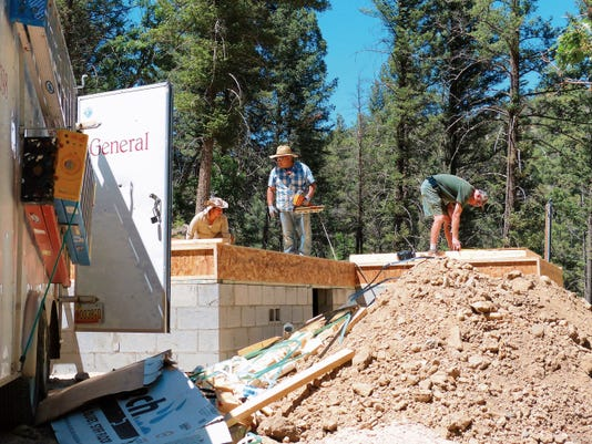 A crew from Dancing Bear Homes works on the floor for a new house on Cedar Creek Drive with a construction value of 217,000.