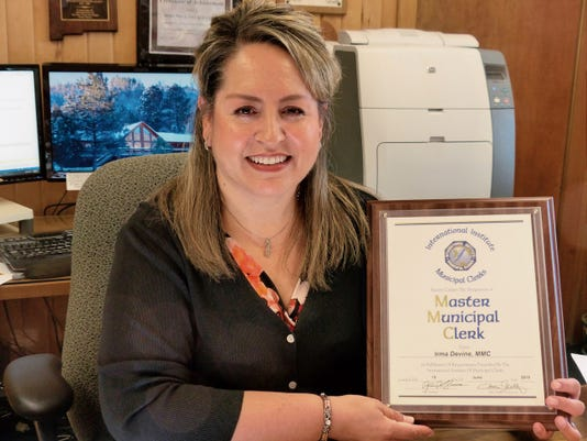 Ruidoso Village Clerk Irma Devine earned a Master Municipal Clerk designation from the International Institute of Municipal Clerks Inc. The title is awarded only to those who complete demanding education requirements and have a record of significant contributions to their local government, their community and state, according to IIMC President Monica Martinez Simmons.