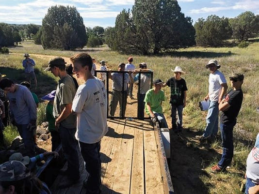 A group of 46 Boy Scouts and adults from the Geronimo District of the Yucca Council gathered over the weekend at Fort Bayard to work on a soil erosion project. The group moved six tons of rocks over the weekend, and scouts came from Silver City, Cliff, and Deming to work on the project. Courtesy Photo
