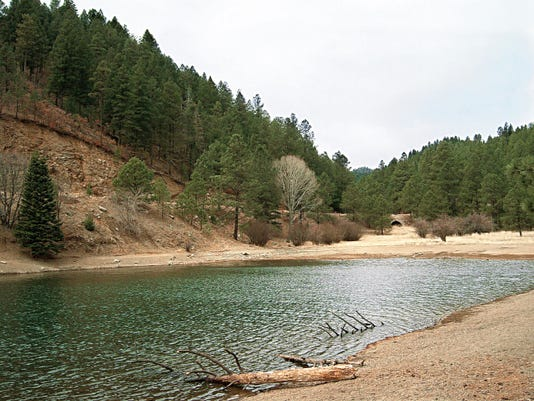 Crews are attempting to drain Bonito Lake so engineers can do necessary surveys and analysis.