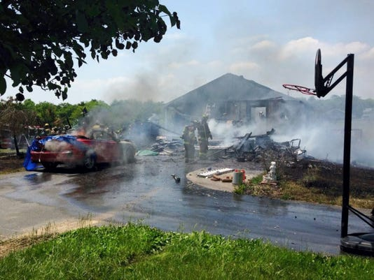 Crews battled a house fire at 9197 Heisey Road on Friday afternoon.