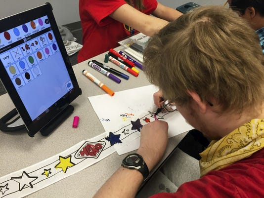A Lincoln Intermediate Unit No. 12 student colors during Augmentative Communication and Electronic Systems day on May 22.