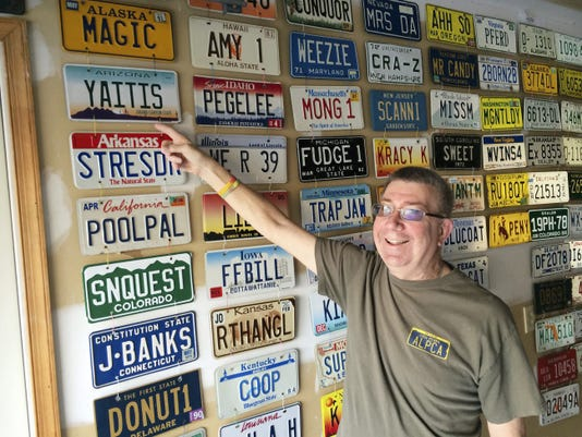 Arthur Levine shows off his collection of vanity plates.