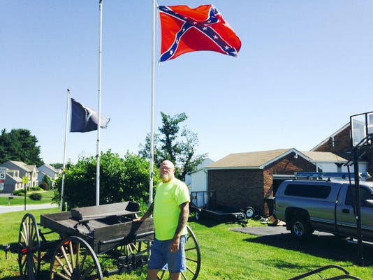Steve Elliott, 61, stands by his Confederate flag on Windsor Road in Windsor Township. Elliott said he sees the flag as a symbol of his heritage — his family is from West Virginia — not as one of slavery, and he has no plans to take it down.