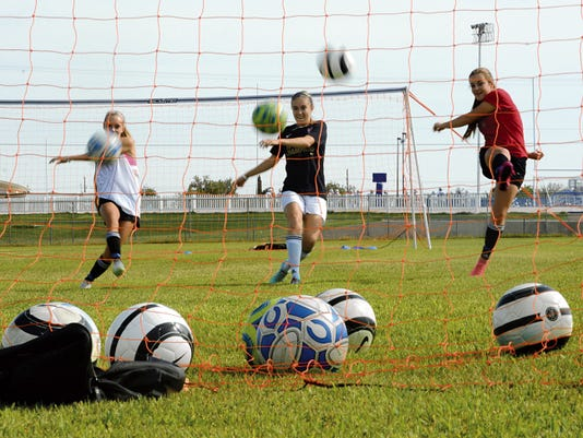Matt Hollinshead — Current-Argus Carlsbad girls soccer's Rylee Hoover, Lauryn Wade and Julie Thompson bring speed and energy to the offense in 2015.