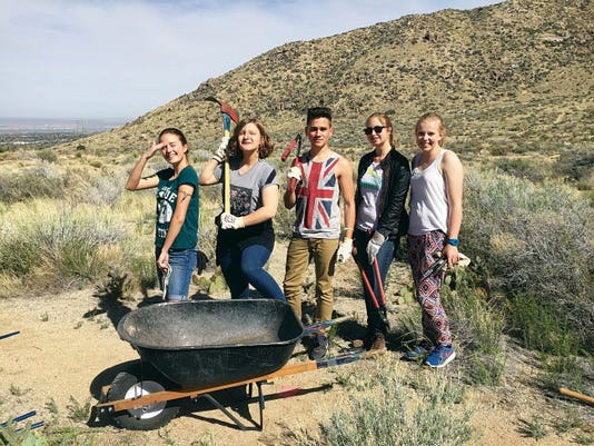 Nino Rostomashvili, an exchange student from the Republic of Georgia, second from left, volunteers with the Open Space Division of the City of Albuquerque on Global Youth Service Day.