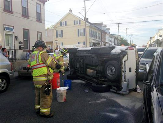 City crash: Lebanon firefighters spread an absorbent to soak up fluids from a Chevrolet Blazer that rolled onto its side in the 300 block of South Fifth Street on Sunday. In the report issued Thursday, police said the driver, Kayla Ream, 20, of 1730 S. McKinley Ave., ran a stop sign at South Fifth and Locust streets at 6:38 p.m. Her SUV and a vehicle driven by Aleah Fauver, 31, of 317 Park Ave., collided. The impact also caused damage to three vehicles owned by Ryan Boddy, 312 S. Fifth St.; Mike Rothermel, 2075 Weavertown Road; and Lamont Stanley, 430 Locust St., that were parked on the street, police said. Ream suffered minor injuries. She was not cited.