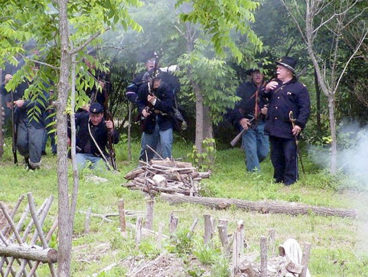 The 93rd Pennsylvania Volunteer Infantry, led by Capt. Dennis Shirk, right, in action at Camp Geiger, Whitehall, in this photo taken in 2010. Today, Shirk, of Myerstown, commands a group of 30 re-enactors who preserve the legacy of the regiment that was formed in the early months of the Civil War in the fall of 1861.