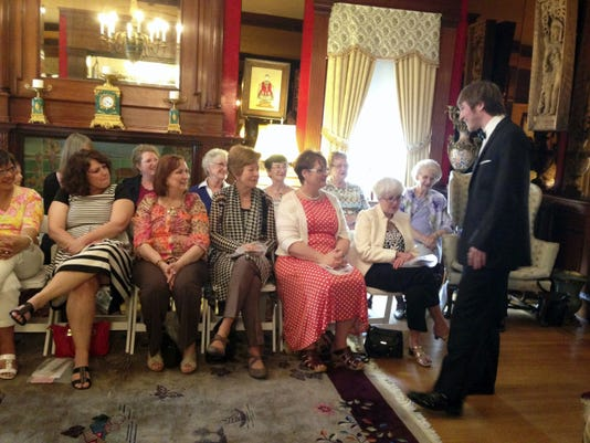 Fashion show attendees check out a tuxedo at the Hanover Area Historical Society's fashion show April 19.