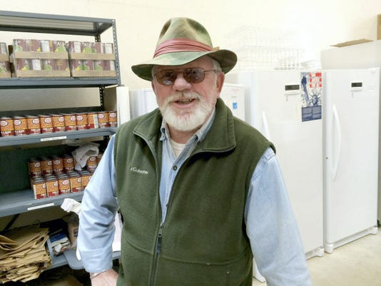 Bill Stone, a retired Baltimore City cop, now volunteers at the food pantry at Christ Lutheran Church in Spry.