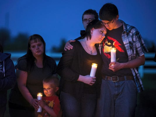 Camryn Liszewski, 16, embraces boyfriend Brady Heim, during a vigil for Camryn's mother, Jennifer Liszewski, and brother Eryk who remains in critical care after an alleged attempted murder-suicide last week. Liszewski gathered friends and family to speak remembrances of her mother, who police accuse of shooting Eryk before turning a gun on herself.