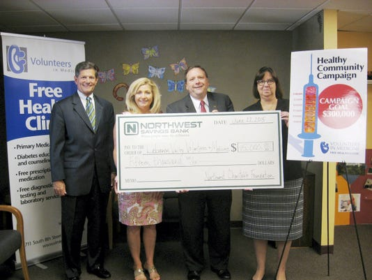 Pictured with an over-sized check recently are, from left Bob Phillips, Volunteers in Medicine board president; Linda Jackson, executive director; Rich Carter, Northwest Charitable Foundation senior vice president and district manager; and Nancy May, Northwest  PA and Maryland regional president. The foundation presented a check for 15,000 to VIM's Healthy Community Campaign, which has raised 302,000.