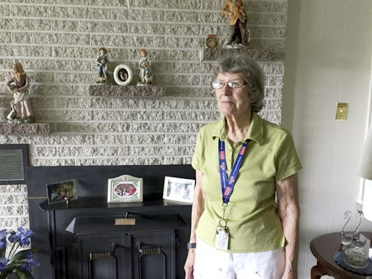 Iris Henry in the living room of the house she has lived in for almost all of her life.