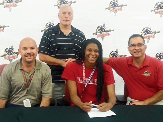 """Centennial High School senior Elexias Patterson signed a Letter of Intent to play college volleyball at Otero Junior College in Colorado last week.   """"It just means that I can continue doing what I love to do and I can get better so I can play Division I afterwards,"""" Patterson said.   Patterson helped the Hawks win the Class 5A state championship this fall.   """"I chose Otero because it gives me a chance to get my grades up so I have a better chance of going to a Division I,"""" Patterson said.   Courtesy photo"""