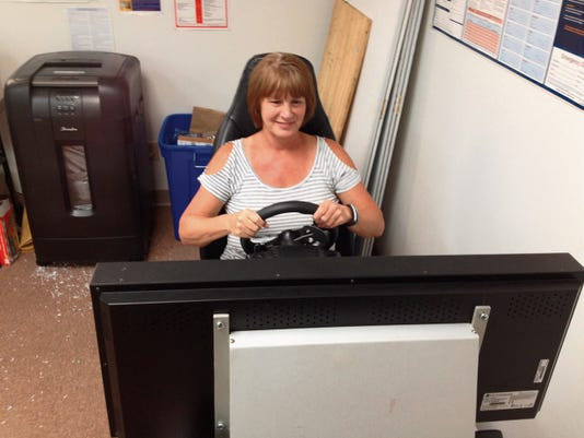 Cindy McClean, Grant County DWI Program coordinator, demonstrates the usage of the program's simulator on Wednesday at her office in Silver City. Randal Seyler - Sun-News