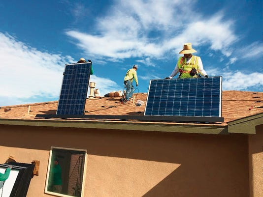 Workers with SolarCity in late July completed their first installation by the Las Cruces consultant team at 4607 Arabela. (Courtesy photo)