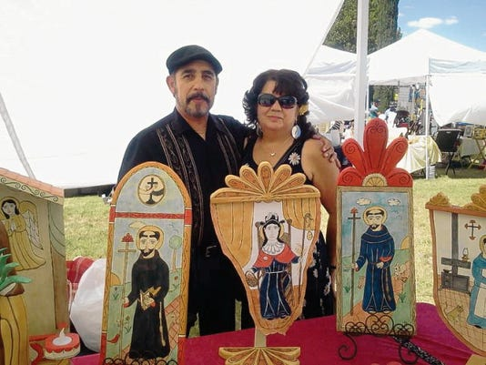 Santero Margarito Mondragon, here with his wife Gloria, carries on a santero tradition of creating religious art that dates back to his great-grandfather. He will show retablos, bultos, cross and altar pieces at the Franciscan Festival of Fine Arts, Saturday and Sunday, Sept. 6, at Holy Cross Retreat Center in Mesilla Park.