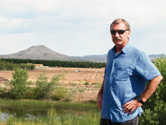 Courtesy photo   SWEC founder and director Kevin Bixby stands near the current shallow pond that will be dug to a depth below groundwater, allowing the pond to fill with water and provide habitat for wildlife and fish.