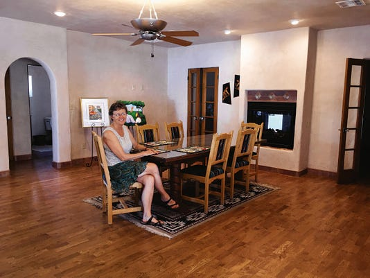 """Courtesy photo   Lisa Willman sits in her downtown adobe """"dream green home"""" on Miranda Street that she and her husband renovated with help from experts."""