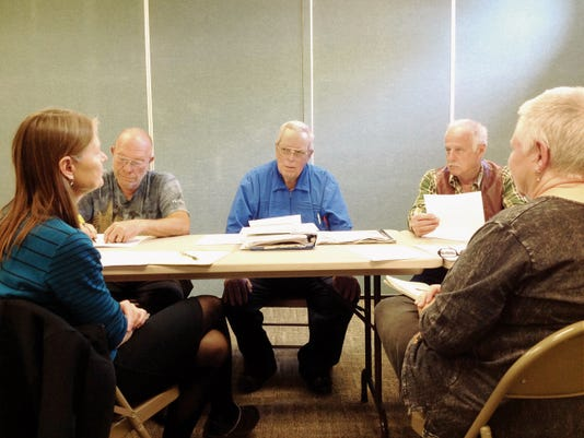 The Silver City Library Board discusses the summer reading program on Wednesday at the library. Attending were, from left, Library Director Eileen Sullivan, from left, board member Dave Krisch, foundation member Ted Lynn, potential board member Mike Dowd and town councilor Lynda Aiman-Smith.