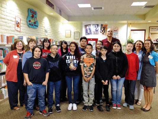 Attending the charter meeting of the Snell Middle School Builder´s Club on March 30 were, front row from left: Keith Mohr, Ozzy Delgado, Desiree Sias, Gabriel Sedillos, Alize Arredondo, Courtney Cuellar, Rudy Madrid, Lori Bonomo, Kiwanis Southwest District Division 7 Lt. Governor, and Irene Carbajal, Kiwanis advisor.   Back row, from left: Alma Carson, Kiwanis Southwest District K-Kids adminstrator, Cindy Lee, faculty advisor, Danielle Trujillo, Samantha Trujillo, Jose Ruiz, Chantel Griggs, Craig Pfeifer, president of the Kiwanis Club of Silver City. Courtesy Photo