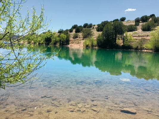 Danny Udero/Sun-News   Bill Evans Lake sits above the Gila River and is home to trout, largemouth bass, crappie, channel catfish and bluegill.