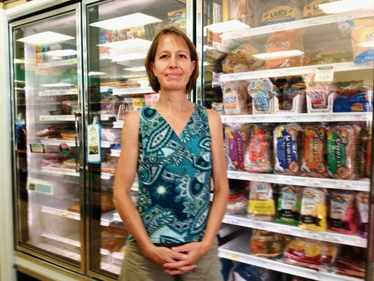 Rachel Bighley, founder of the Gluten Freedom Group in Silver City, shows the gluten free bread section in the Silver City Food Co-op on Friday. Shannon Seyler - Sun-News