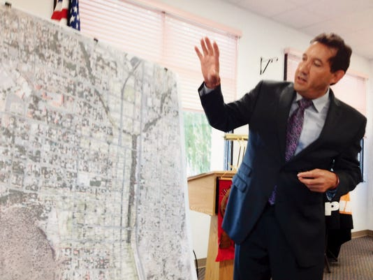 Grant County Tax Assessor Raul Turrieta discusses the newly created TIF tax district which is being established in downtown Silver City during Thursday's Chamber of Commerce meeting. Randal Seyler - Sun-News