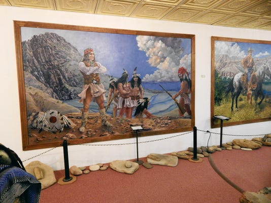 Ancient pottery and artifacts surround artist Delmas Howe's historical murals depicting famed warrior and medicine man Geronimo at Geronimo Springs Museum, located at the site where the Apache leader reportedly came to enjoy the community's healing waters.