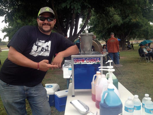 JESSICA ONSUREZ CURRENT-ARUGS   Snow cones were part of the offering at the second annual Peace on the River celebration despite the chilly temperatures and rain that had many staying home.