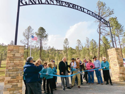 Members of the Ruidoso Greeters, the village cemetery board and village council prepare to mark the official opening of the village's new cemetery.
