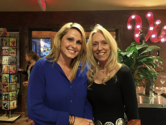 Julie Gilliland and Marianne Mohr, general manager of Ruidoso News, enjoy open mic night at Sacred Grounds.