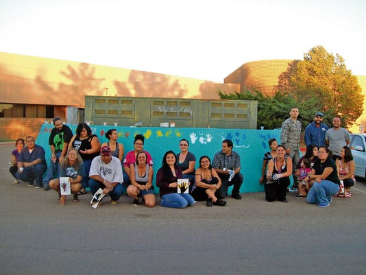 """School Parents came together to paint a colorful hand print mural During a Tularosa HELP-NM Parent Center Committee meeting Sept. 16. The mural includes the message of """"Together we grow, together we get a head start."""" HELP-NM was created and incorporated as Home Education Livelihood Program, Inc. in 1965 by the interdenominational New Mexico Council of Churches and its successor, the New Mexico Conference of Churches and Church Women United, according to their website. The organization endeavors to provide services to individuals and families including migrant families, self-employed farmers and ranchers, low-income families, abused and neglected children, senior citizens, people with disabilities, and disadvantaged youth. The Tularosa HELP-NM Parent Center Committee would like to make the community aware of their school family and that it has room for growth."""