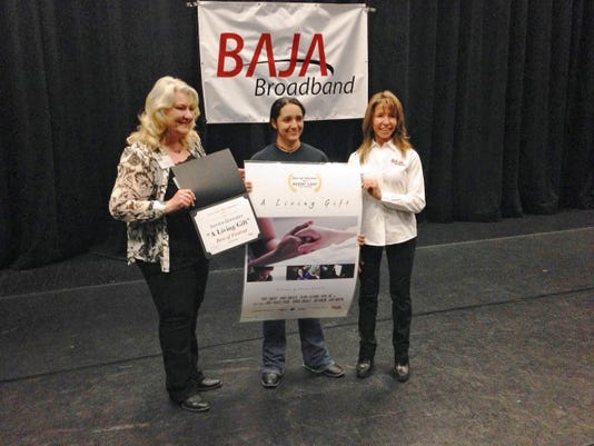 "2015 ""Best of Festival"" Winner Aurora Gonzales from Data Charter School in Albuquerque won for her film ""The Living Gift."" Gonzales poses with Otero County Film Liaison Jan Wafful (left) and Baja Broadband local festival sponsor, Barbara Mick (right)."