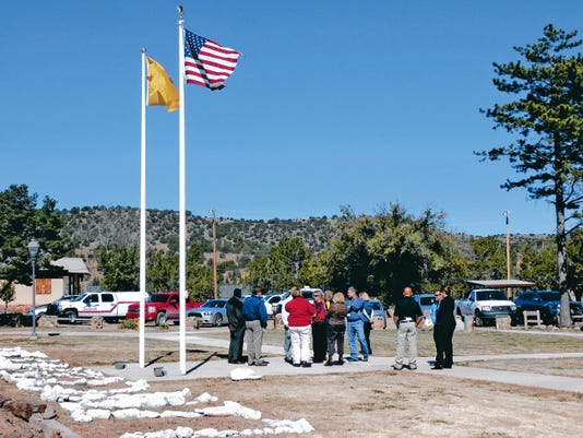 Officials talk outside of the Lincoln Pines Youth Center.