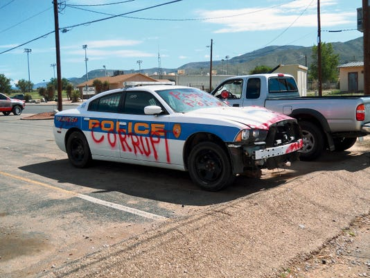 A Body Masters employee in Alamogordo reported that a unknown suspect spray painted graffiti on a Tularosa police patrol car Wednesday evening. Alamogordo police officers continue their investigation into the crime.