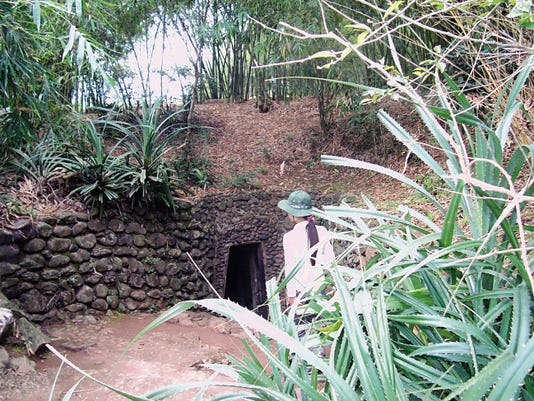 Visitors enter one of the fifteen entrances to the Vinh Moc Tunnels used to shelter the community during bombing raids. The tunnels are now a national park.