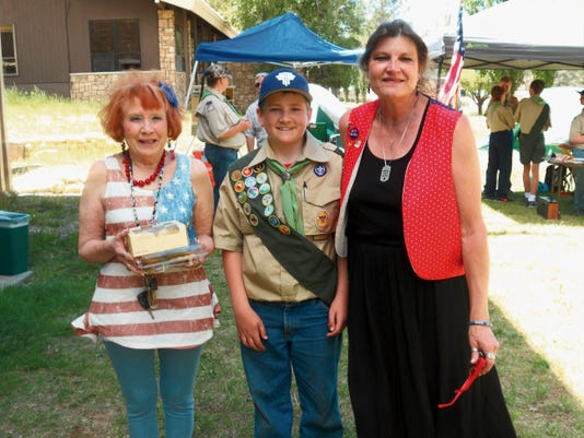 Cheryl Volosyn, Wesley Shaver of the Boys Scouts of America and Kari Dawn Kolander stop for a photo op.