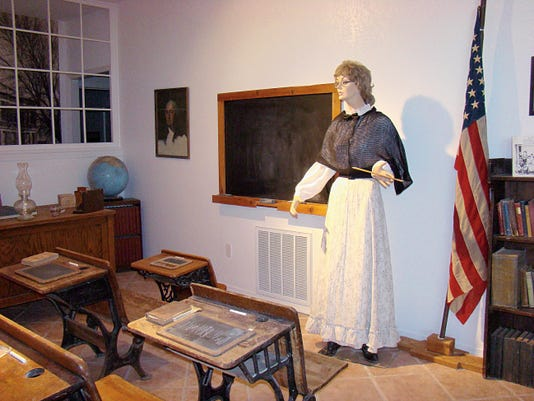 "An early country schoolroom at Carrizozo Heritage Museum shows what school ""learning"" was like in the good old days. This exhibition is one of many of the museum's glimpse into the past flashbacks."