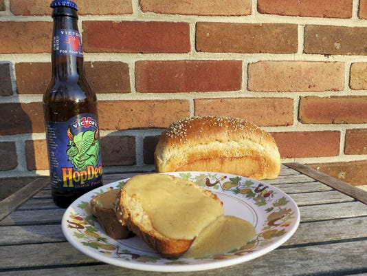 A hearty loaf of bread, a bottle of beer and a block of cheddar cheese come together in Welsh rabbit, the toasted-cheese sandwich of adulthood.