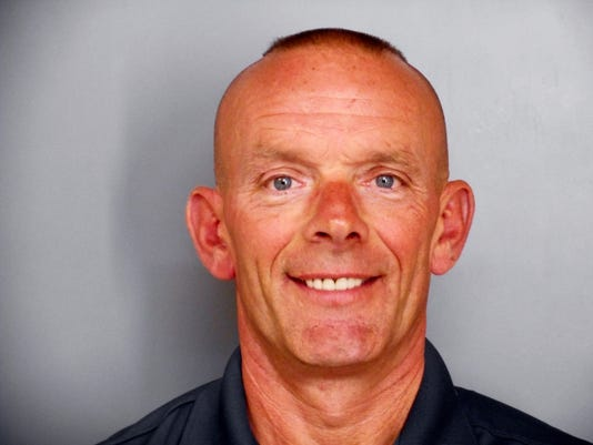 This undated photo provided by the Fox Lake Police Deptartment shows Lt. Charles Joseph Gliniewitz, who was shot and killed Tuesday, Sept. 1, 2015, in Fox Lake, Ill. Police with helicopters, dogs and armed with rifles were conducting a massive manhunt Tuesday in northern Illinois for the individuals believed to be involved in the death of Gliniewitz. (Fox Lake Police Department photo via AP)