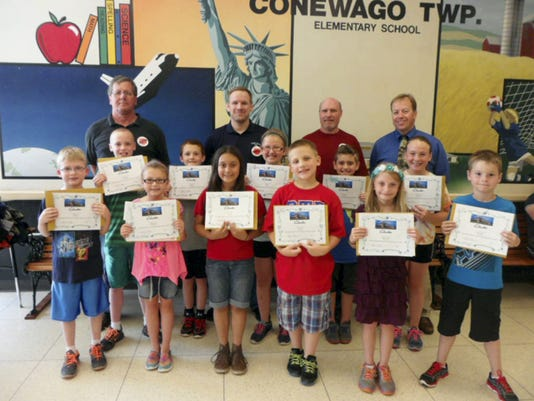 "The Clarks Logistics Center in Hanover partnered with Conewago Township Elementary to challenge the school's third grade students to draw pictures of and name some high-profile pieces of equipment. Afterwards, the winners  went to Clarks Logistics Center's high-tech facility to meet ""the cranes"" they named. Shown, front row, from left, are: Adam Prehoda, Allison Horick, Kaylee Little, Austin Senkewic, Hannah Smith and Austin Schuchart; second row, Hayden Shoemaker, Jacob Lawrence Stabler, Leah Noel, Aiden Morningstar and Alexis Torsella; third row, Roy Miller, maintenance manager; Chris Bentley, vice president of Clarks Hanover Center; Larry Barrick, assistant maintenance manager; and Conewago Township Elementary Principal Larry Sanders. Alyssa Hurst, Amber Miller and Ashley Francisco were unavailable for the photo."