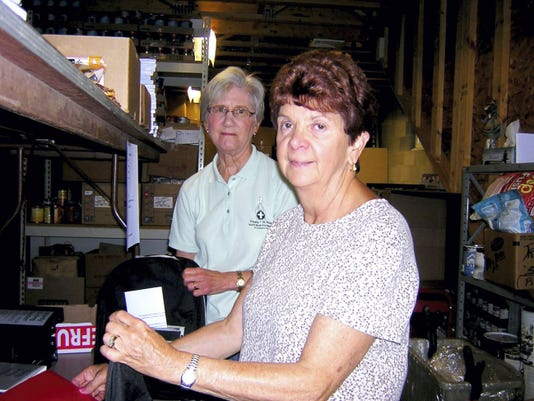 The Women's Club of Spring Grove joined Harvest of Hope Food Pantry of West Manchester Township in filling 182 backpacks with school supplies. From left, Pearl Wintrode and Connie Clancey are shown preparing backpacks. The backpacks were distributed to the children who participated in the food pantry's summer meal program. Supplies were made available through the generous contributions of members of local churches and organizations.