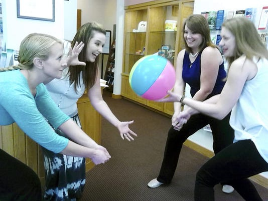 Left to right..Bethany Houser, Nicole Ivie, Jessica Stankovich and Suzanne Biever practice for volleyball tourament at picnic. Marylouise Sholly -- Lebanon Daily News